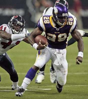 HOUSTON - AUGUST 31:  Running back Adrian Peterson #28 of the Minnesota Vikings breaks a tackle by cornerback Brice McCain #41 of the Houston Texans at Reliant Stadium on August 31, 2009 in Houston, Texas.  (Photo by Bob Levey/Getty Images)