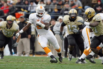 NASHVILLE, TN - NOVEMBER 22: Montario Hardesty #2 of the Tennessee Volunteers carries the ball against D.J. Moore #17 of the Vanderbilt Commodores at Vanderbilt Stadium on November 22, 2008 in Nashville, North Carolina.  (Photo by Kevin C. Cox/Getty Image