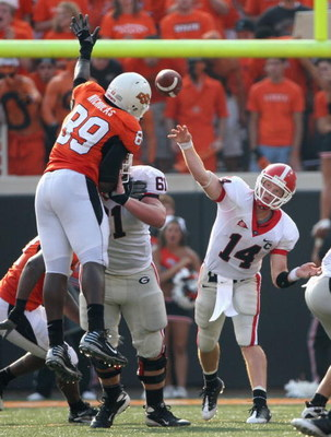 STILLWATER, OK - SEPTEMBER 05:  Quarterback Joe Cox #14 of the Georgia Bulldogs throws a pass that is deflected by tight end Cooper Bassett #80 of the Oklahoma State Cowboys during the college football game at Boone Pickens Stadium on September 5, 2009 in