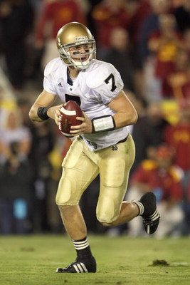 LOS ANGELES - NOVEMBER 29:  Quarterback Jimmy Clausen #7 of the Notre Dame Fighting Irish looks to pass the ball during the game against the USC Trojans at the Memorial Coliseum on November 29, 2008 in Los Angeles, California. (Photo by: Jeff Gross/Getty