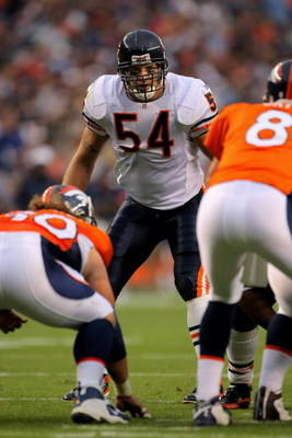 DENVER - AUGUST 30:  Line backer Brian Urlacher #54 of the Chicago Bears awaits the snap against quarterback Kyle Orton #8 of the Denver Broncos during preseason NFL action at INVESCO Field at Mile High on August 30, 2009 in Denver, Colorado. The Bears de