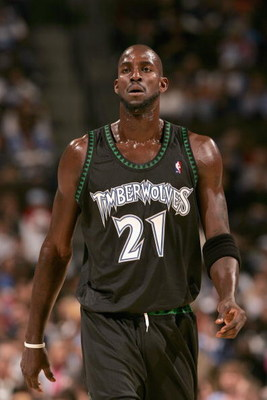 DENVER - NOVEMBER 3:  Kevin Garnett #21 of the Minnesota Timberwolves walks across the court during the game against the Denver Nuggets at Pepsi Center on November 3, 2006 in Denver, Colorado.  The Timberwolves won 112-109.   NOTE TO USER: User expressly