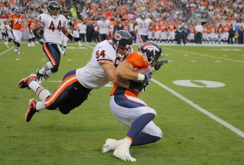 DENVER - AUGUST 30:  Linebacker Brian Urlacher #54 of the Chicago Bears tackles tight end Tony Scheffler #88 of the Denver Broncos during the second quarter at INVESCO Field at Mile High on August 30, 2009 in Denver, Colorado.  (Photo by Doug Pensinger/Ge