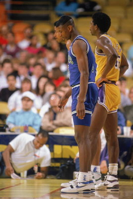 LOS ANGELES - 1990:  Doug West #5 of the Minnesota Timberwolves and A.C. Green #45 of the Los Angeles Lakers wait for the free-throws during a game at the Great Western Forum in Los Angeles, California during the 1989-1990 NBA season.  (Photo by Ken Levin