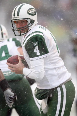 SEATTLE - DECEMBER 21:  Quarterback Brett Favre #4 of the New York Jets looks to hand off the ball during the game against the Seattle Seahawks on December 21, 2008 at Qwest Field in Seattle, Washington. The Seahawks defeated the Jets 13-3. (Photo by Otto