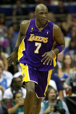 ORLANDO, FL - JUNE 14:  Lamar Odom #7 of the Los Angeles Lakers runs up court in the first half against the Orlando Magic in Game Five of the 2009 NBA Finals on June 14, 2009 at Amway Arena in Orlando, Florida.  NOTE TO USER:  User expressly acknowledges