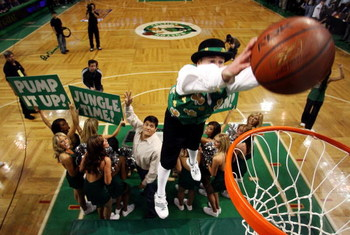 BOSTON - MAY 28:  The Boston Celtics mascot, 'Lucky' dunks the ball after receiving it from Tedy Bruschi of the New England Patriots during a break in play against the Detroit Pistons during Game Five of the Eastern Conference finals during the 2008 NBA P