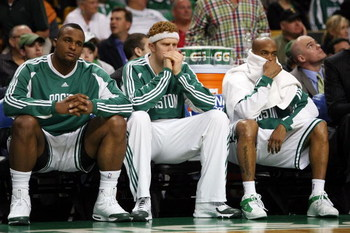 BOSTON - MAY 17:  Glen Davis #11, Brian Scalabrine #44 and Stephon Marbury #8 of the Boston Celtics watch from the bench as  the Orlando Magic win Game Seven of the Eastern Conference Semifinals during the 2009 NBA Playoffs at TD Banknorth Garden on May 1