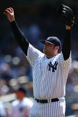 NEW YORK - AUGUST 30:  Joba Chamberlain #62 of the New York Yankees calls for the ball before pitching against the Chicago White Sox during their game on August 30, 2009 at Yankee Stadium in the Bronx borough of New York City.  (Photo by Chris McGrath/Get
