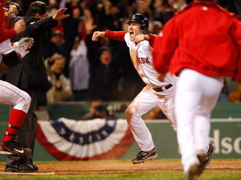 BOSTON - OCTOBER 6: Jason Bay #44 of the Boston Red Sox celebrates after scoring the winning run against the Los Angeles Angels of Anaheim for the American League Division Series at Fenway Park on October 6, 2008 in Boston, Massachusetts. (Photo by Jim Ro