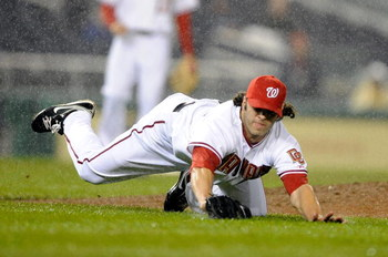 WASHINGTON - APRIL 20:  Joe Beimel #97 of the Washington Nationals dives for the ball during the game against the Atlanta Braves at Nationals Park on April 20, 2009 in Washington, DC.  (Photo by Greg Fiume/Getty Images)