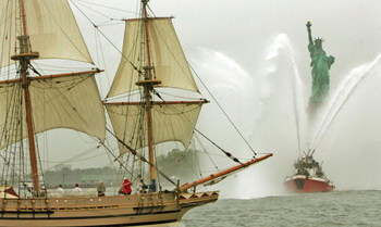 NEW YORK - JUNE 26:  A fireboat welcomes the Godspeed, a 17th-century replica ship, as it sails through New York Harbor past the Statue of Liberty during an 80-day tour of six East Coast cities June 26, 2006 in New York City. The ship is a replica of one 