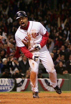 BOSTON - OCTOBER 17:  Dave Roberts #31 of the Boston Red Sox celebrates after scoring the game-tying run on a single by Bill Mueller #11 in the ninth inning against the New York Yankees during game four of the American League Championship Series on Octobe