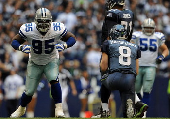 IRVING, TX - NOVEMBER 27:  Tackle Tank Johnson #95 of the Dallas Cowboys celebrates a sack against Matt Hasselbeck #8 of the Seattle Seahawks in the second quarter at Texas Stadium on November 27, 2008 in Irving, Texas.  (Photo by Ronald Martinez/Getty Im