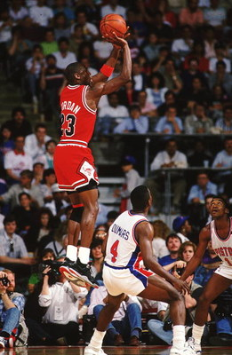 1988:  Michael Jordan #23 of the Chicago Bulls jumps to shoot the ball during a game against the Detroit Pistons. NOTE TO USER: It is expressly understood that the only rights Allsport are offering to license in this Photograph are one-time, non-exclusive