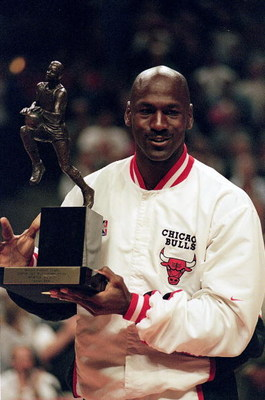 12 Jun 1998:  Michael Jordan #23 of the Chicago Bulls holds up the MVP trophy before the Eastern Conference game against the Indiana Pacers at the United Center in Chicago, Illinois. The Bulls defeated the Pacers 104-98. .  Mandatory Credit: Jonathan Dani