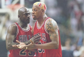 26 May 1997:  Guard Michael Jordan holds back forward Dennis Rodman of the Chicago Bulls as he argues with an official during a playoff game against the Miami Heat at the Miami Arean in Miami, Florida.  The Heat won the game 87-80. Mandatory Credit: Andy