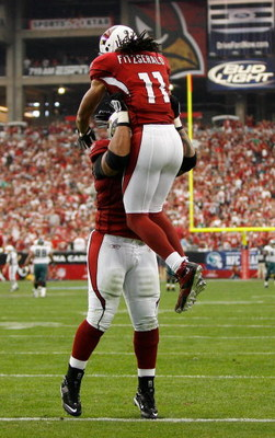 GLENDALE, AZ - JANUARY 18:  Wide receiver Larry Fitzgerald #11 of the Arizona Cardinals celebrates with guard Reggie Wells #74, after a touchdown in the second quarter against the Philadelphia Eagles during the NFC championship game on January 18, 2009 at
