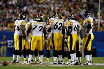 TAMPA, FL - FEBRUARY 01: Offensive linemen (L-R) Willie Colon #74, Darnell Stapleton #72, Justin Hartwig #62,  Chris Kemoeatu #68 and Max Starks #78 of the Pittsburgh Steelers stand in the huddle against the Arizona Cardinals during Super Bowl XLIII on Fe