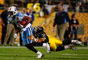 PITTSBURGH - SEPTEMBER 10:  James Farrior #51 of the Pittsburgh Steelers brings down Justin Gage #12 of the Tennessee Titans during the game at Heinz Field on September 10, 2009 in Pittsburgh, Pennsylvania. (Photo by Scott Boehm/Getty Images)
