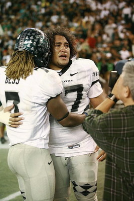 HONOLULU - DECEMBER 2:  Siave Seti #97 of the Hawaii Warriors and Devon Bess #7  celebrate the victory against the Washington Huskies on December 1, 2007 at Aloha Stadium in Honolulu, Hawaii.  Hawaii won 35-28 and finished the season undefeated at 12-0.