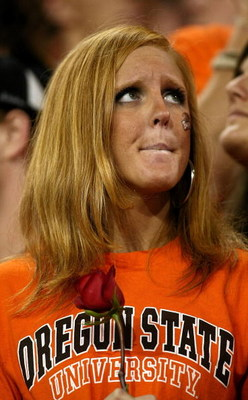 CORVALLIS, OR - NOVEMBER 29:  An Oregon State Beaver fan shows her dejection after a 65-38 loss to Oregon Ducks, dashing the Beavers' Rose Bowl hopes, at Reser Stadium on November 29, 2008 in Corvalis, Oregon.  (Photo by Jonathan Ferrey/Getty Images)