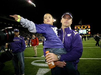 SEATTLE - SEPTEMBER 05:  Head coach Steve Sarkisian of the Washington Huskies leaves the field with son Brady after losing to the LSU Tigers 31-23 on September 5, 2009 at Husky Stadium in Seattle, Washington. (Photo by Otto Greule Jr/Getty Images)