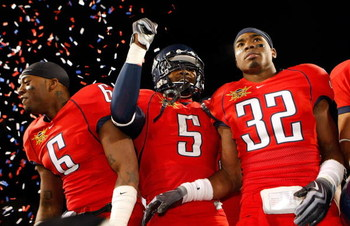 LAS VEGAS - DECEMBER 20:  Devon Ross #6, Nic Grigsby #5 and Nate Ness #32 of the Arizona Wildcats celebrate after the team's 31-21 victory over the Brigham Young University Cougars in the Pioneer Las Vegas Bowl at Sam Boyd Stadium December 20, 2008 in Las