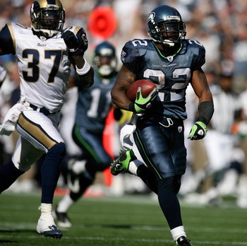 SEATTLE - SEPTEMBER 13:  Running back Julius Jones #22 of the Seattle Seahawks rushes for a touchdown in the third quarter against James Butler #37 of the St. Louis Rams on September 13, 2009 at Qwest Field in Seattle, Washington. The Seahawks defeated th