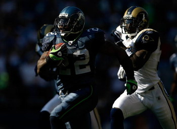 SEATTLE , WA - SEPTEMBER 13:  Julius Jones #22 runs for a touchdown against the Seattle Seahawks of the St. Louis Rams at Qwest Field on September 13, 2009 in Seattle, Washington.  (Photo by Jonathan Ferrey/Getty Images)
