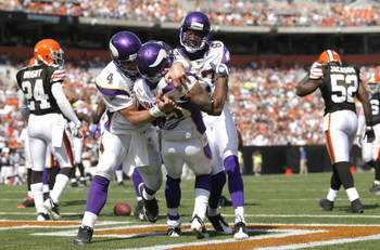 CLEVELAND - SEPTEMBER 13:  Percy Harvin #12 of the Minnesota Vikings celebrates with Brett Farve #4 and Bernard Berrian #87 after scoring a touchdown against the Cleveland Browns at Cleveland Browns Stadium on September 13, 2009 in Cleveland, Ohio.  (Phot