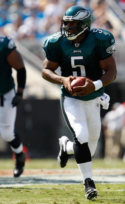 CHARLOTTE, NC - SEPTEMBER 13:  Quarterback Donovan McNabb #5 of the Philadelphia Eagles runs with the ball in the second half of their NFL season opener against the Carolina Panthers at Bank of America Stadium on September 13, 2009 in Charlotte, North Car