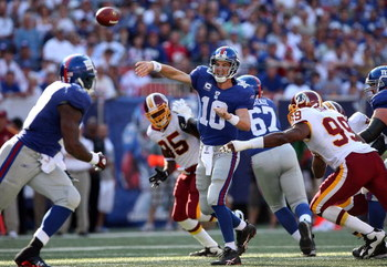 EAST RUTHERFORD, NJ - SEPTEMBER 13:  Eli Manning #10 of the New York Giants throws a pass against the Washington Redskins on September 13, 2009 at Giants Stadium in East Rutherford, New Jersey.  (Photo by Jim McIsaac/Getty Images)