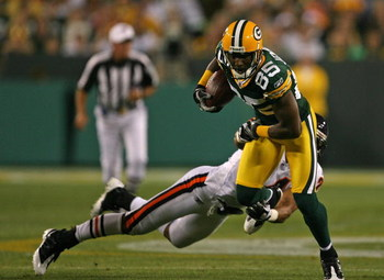 GREEN BAY, WI - SEPTEMBER 13: Greg Jennings #85 of the Green Bay Packers breaks away from Al Afalava #24 of the Chicago Bears on September 13, 2009 at Lambeau Field in Green Bay, Wisconsin. (Photo by Jonathan Daniel/Getty Images)