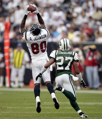 HOUSTON - SEPTEMBER 13:  Wide receiver Andre Johnson #80 of the Houston Texans makes a reception in front of cornerback Donald Strickland #27 of the new York Jets at Reliant Stadium on September 13, 2009 in Houston, Texas.  (Photo by Bob Levey/Getty Image