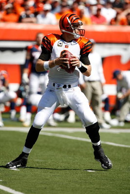 CINCINNATI, OH - SEPTEMBER 13:  Quarterback Carson Palmer #9 of the Cincinnati Bengals drops back to pass the football against the Denver Broncos at Paul Brown Stadium on September 13, 2009 in Cincinnati, Ohio. The Broncos defeated the Bengals 12-7. (Phot