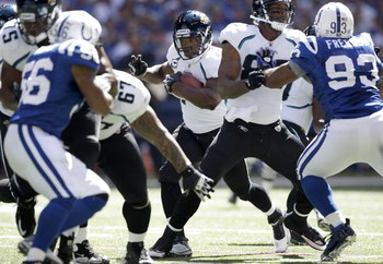 INDIANAPOLIS - SEPTEMBER 13:  Maurice Jones-Drew #32 of the Jacksonville Jaguars runs with the ball during the game against the Indianapolis Colts  at Lucas Oil Stadium on September 13, 2009 in Indianapolis, Indiana.  (Photo by Andy Lyons/Getty Images)