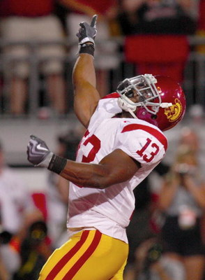 COLUMBUS, OH - SEPTEMBER 12: Stafon Johnson #13 of the USC Trojans celebrates his first quarter touchdown against the Ohio State Buckeyes during the game at Ohio Stadium on September 12, 2009 in Columbus, Ohio. (Photo by Gregory Shamus/Getty Images)