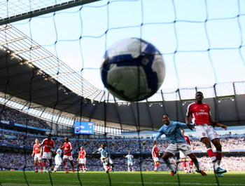 MANCHESTER, ENGLAND - SEPTEMBER 12:  Joleon Lescott (2nd R) of Manchester City watches team-mate Micah Richards' header hit the back of the net during the Barclays Premier League match between Manchester City and Arsenal at the City of Manchester Stadium