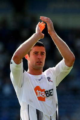 PORTSMOUTH, ENGLAND - SEPTEMBER 12: Gary Cahill of Bolton Wanderers applauds the Fans at the end of  the Barclays Premier League match between Portsmouth and Bolton Wanderers at Fratton Park on September 12, 2009 in Portsmouth, England.  (Photo by Phil Co