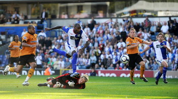 BLACKBURN, ENGLAND - SEPTEMBER 12: Jason Roberts of Blackburn Rovers sets up the third goal for team mate David Dunn (R) to poach on the line during the Barclays Premier League match between Blackburn Rovers and Wolverhampton Wanderers at Ewood Park on Se