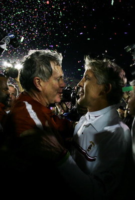 PASADENA, CA - JANUARY 04:  Head coach Mack Brown of the Texas Longhorns is congratulated by head coach Pete Carroll of the USC Trojans after defeating the Trojans 41-38 to win the BCS National Championship Rose Bowl Game on January 4, 2006 in Pasadena, C