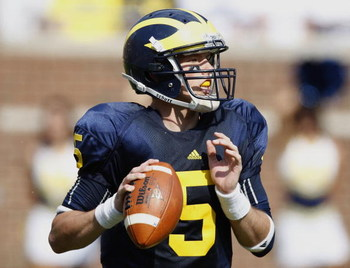 ANN ARBOR, MI - SEPTEMBER 05:  Tate Forcier #5 of the Michigan Wolverines gets ready to throw a second quarter pass while playing the Western Michigan Broncos on September 5, 2009 at Michigan Stadium in Ann Arbor, Michigan.  (Photo by Gregory Shamus/Getty
