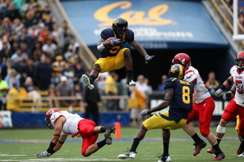 BERKELEY, CA - SEPTEMBER 12:  Jeremy Ross #3 of the California Golden Bears jumps over Kyle Wilkins #7 of the Eastern Washington Eagles on a punt return at Memorial Stadium on September 12, 2009 in Berkeley, California.  (Photo by Jed Jacobsohn/Getty Imag