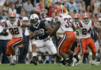 STATE COLLEGE, PA - SEPTEMBER 12: Tail back Evan Royster #22 of the Penn State Nittany Lions rushes through linebacker Doug Hogue #32 and safety Mike Holmes #35 of the Syracuse Orangemen during the first half at Beaver Stadium  September 12, 2009 in State
