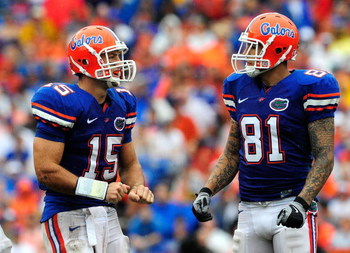 GAINESVILLE, FL - SEPTEMBER 12:  Tim Tebow #15 of the Florida Gators speaks with Aaron Hernandez #81 during the game against the Troy Trojans  at Ben Hill Griffin Stadium on September 12, 2009 in Gainesville, Florida.  (Photo by Sam Greenwood/Getty Images