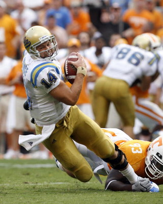 KNOXVILLE, TN - SEPTEMBER 12: Kevin Prince #14 of the UCLA Bruins is sacked by Montori Hughes #93 of the Tennessee Volunteers on September 12, 2009 at Neyland Stadium in Knoxville, Tennessee. (Photo by Joe Murphy/Getty Images)