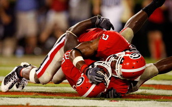 ATHENS, GA - SEPTEMBER 12:  Brandon Boykin #2 and Rennie Curran #35 of the Georgia Bulldogs celebrate a fourth down defensive stop against the South Carolina Gamecocks at Sanford Stadium on September 12, 2009 in Athens, Georgia.  (Photo by Kevin C. Cox/Ge