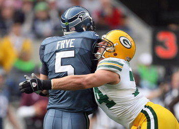 SEATTLE - OCTOBER 12:  Aaron Kampman #74 of the Green Bay Packers tackles quarterback Charlie Frye #5 of the Seattle Seahawks on October 12, 2008 at Qwest Field in Seattle, Washington. The Packers defeated the Seahawks 27-17. (Photo by Otto Greule Jr./Get