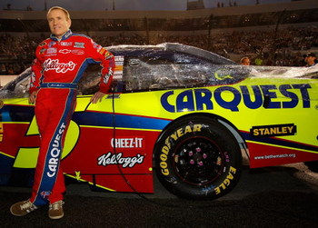 RICHMOND, VA - SEPTEMBER 12:  Mark Martin, driver of the #5 Kellogg's Chevrolet, stands next to his car prior to the NASCAR Sprint Cup Series Chevy Rock & Roll 400 at Richmond International Raceway on September 12, 2009 in Richmond, Virginia.  (Photo by C